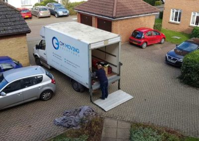 CM Moving Solutions - Carefully loading the van